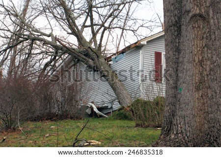 Tornado damage to a home - stock photo