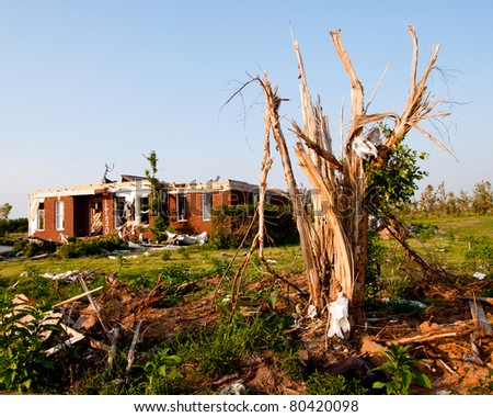 Tornado-damaged land and home in northern Alabama one month after storm. - stock photo