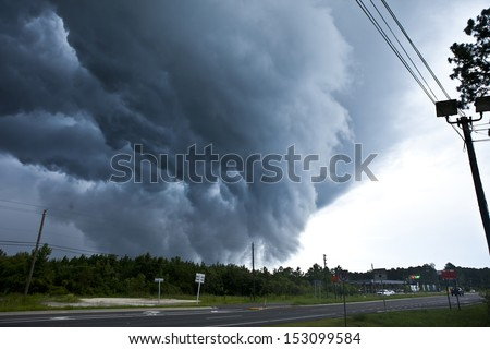 tornado forming from wall cloud in central florida - stock photo