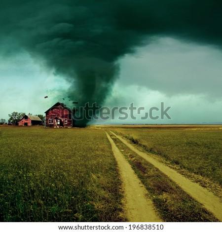 Tornado hitting a house - stock photo