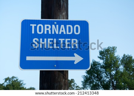 Tornado shelter sign to guide people to safety in tornado emergency - stock photo