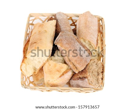 Torned bread in basket. Isolated on a white background.