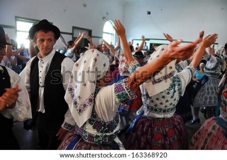 TOROCKO (RIMETEA) - AUG 30: Dancers in traditional Slovak costumes dancing at the Hungarian folklore festival, during the Rimetea Village Days. On August 30, 2013 in Torocko, Transylvania, Romania - stock photo