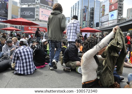 TORONTO - APRIL 20:   Marijuana legalization supporters enjoying themselves during the annual marijuana 420 event at Yonge & Dundas Square  on April 20  2012 in Toronto, Canada. - stock photo