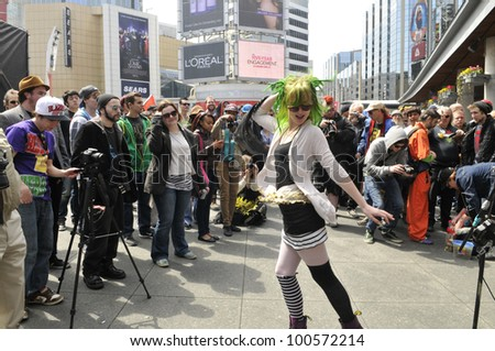 TORONTO - APRIL 20: Supporters of legalization of marijuana having fun  during the annual marijuana 420 event at Yonge & Dundas Square  on April 20  2012 in Toronto, Canada. - stock photo