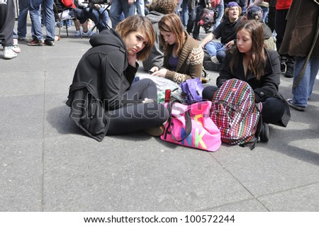 TORONTO - APRIL 20: Teenage girls in front of a bong  during the annual marijuana 420 event at Yonge & Dundas Square  on April 20  2012 in Toronto, Canada. - stock photo