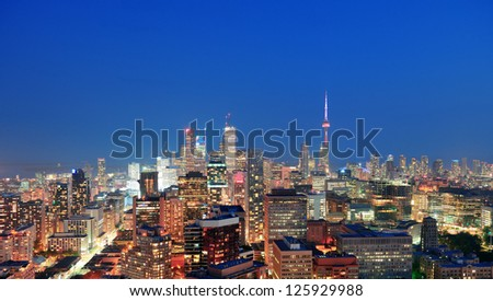 Toronto at dusk with city light and urban skyline with skyscrapers - stock photo
