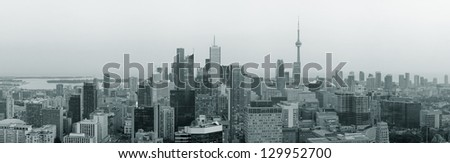 Toronto at dusk with city light and urban skyline with skyscrapers in black and white - stock photo