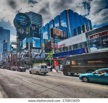 TORONTO - AUG 17: Tourists enjoy city streets, August 17, 2009 in Toronto. Nine million people visit the city every year. - stock photo