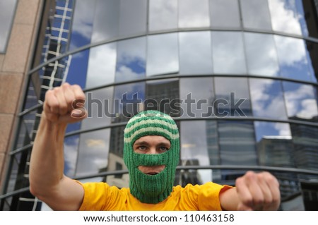 """TORONTO -AUGUST  17: A agitated  protester wearing a balaclava during a protest rally organized to free """"pussy riot""""on August 17 2012 in Toronto, Canada. - stock photo"""