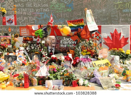 TORONTO - AUGUST 30: A makeshift memorial honoring the late Jack Layton, Canadian Federal NDP Leader, on August 30, 2011 in Toronto. - stock photo