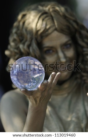 TORONTO-AUGUST 25: A performer juggling with a crystal ball during the Buskerfest Festival on August 25, 2012 in Toronto, Canada. - stock photo