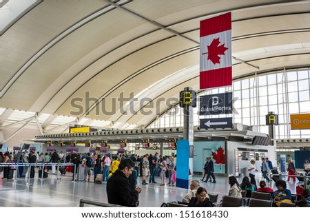 TORONTO - AUGUST 15: Pearson International Airport. One of largest and busiest airport in the world. About 1100 planes take off or land in a day. As seen August 15, 2013 in Toronto, Canada - stock photo