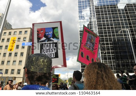 "TORONTO -AUGUST  17:  People holding banners and placards during a protest rally organized to free ""pussy riot""on August 17 2012 in Toronto, Canada. - stock photo"