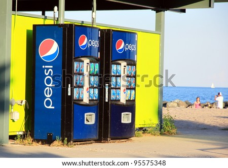 "TORONTO - AUGUST 27: Pepsi vending machines on August 27, 2011 in Toronto. Created in 1898 and introduced as ""Brad's Drink"", it was later renamed as Pepsi-Cola on June 16, 1903, then to Pepsi in 1961. - stock photo"