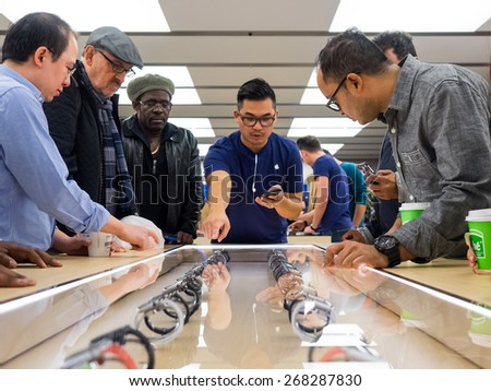 TORONTO, CANADA - APRIL 10, 2015: Apple staff introduces the new Apple Watch to the customers at the store. Apple begins the Apple Watch pre-order in Canada this day. - stock photo