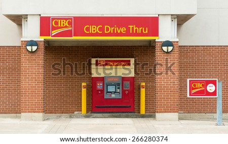 TORONTO,CANADA-APRIL 2,2015: CIBC Drive Through ATM; The Canadian Imperial Bank of Commerce, commonly CIBC, is one of Canada's chartered banks, fifth largest by deposits. - stock photo