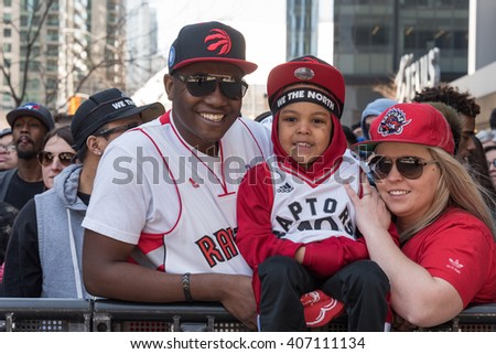 TORONTO,CANADA-APRIL 16,2016: NBA: Raptors play off game 1, fans gathered outside the Air Canada Centre (ACC) to watch in big screen. - stock photo
