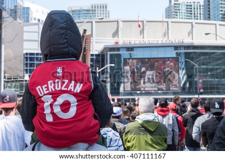 TORONTO,CANADA-APRIL 16,2016: NBA: Raptors play off game 1, fans gathered outside the Air Canada Centre (ACC) to watch in big screen.