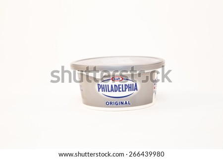 TORONTO, CANADA - APRIL 02 2015 :  Spreadable Kraft Philidelphia Original Cream Cheese product in a small plastic container on a bright background as an illustrative editorial - stock photo