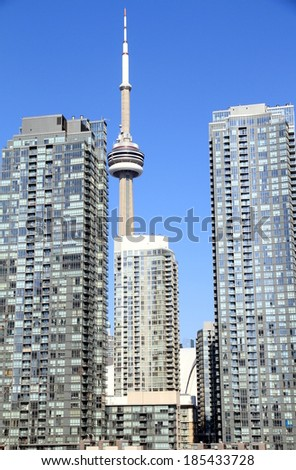TORONTO, CANADA - APRIL 2, 2014: The CN Tower and modern condo buildings in Downtown Toronto, Canada. The CN Tower is a famous attraction with more than 2 million visitors annually, and 1,815 ft. tall - stock photo