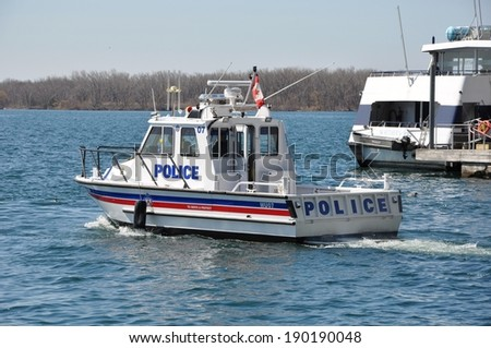 Toronto, Canada - April 27, 2014: The Toronto Police Marine Unit is responsible for all waterways within Toronto. They also enforce the Canada Shipping Act, Toronto Port Authority by-laws, etc. - stock photo