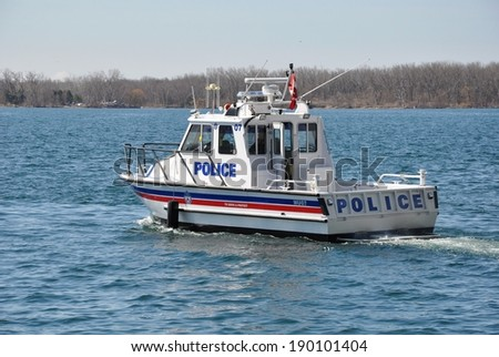 Toronto, Canada - April 27, 2014: Toronto Police boat patrolling the harbour. - stock photo