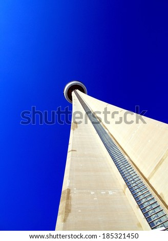 TORONTO, CANADA - APRIL 2, 2014: View of the the CN Tower from ground level and clear blue sky in the background. - stock photo