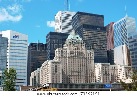 TORONTO, CANADA - AUGUST 1: downtown on August 1, 2008 in Toronto, Canada. Modern skyscrapers and the old fashioned Fairmont Royal York Hotel within financial and entertainment districts in downtown. - stock photo