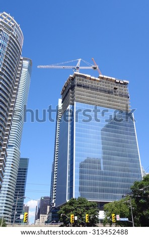 TORONTO, CANADA - AUGUST 9, 2015: Modern building under construction on the Lake Ontario in Toronto, Canada.