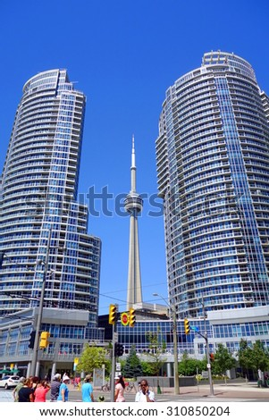 TORONTO, CANADA - AUGUST 9, 2015: Modern luxury condominiums and the CN Tower on the Lake Ontario in Toronto, Canada. - stock photo