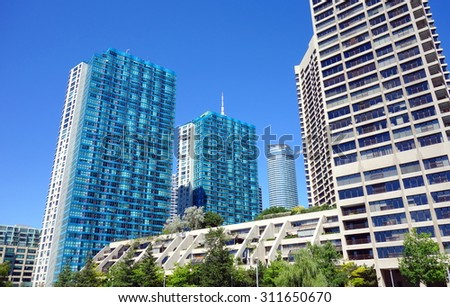 TORONTO, CANADA - AUGUST 9, 2015: Modern luxury condominiums on the Lake Ontario in Toronto, Canada.  - stock photo