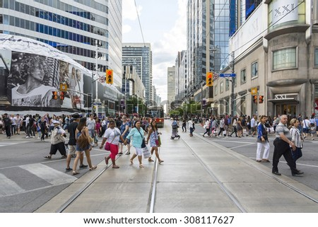TORONTO,CANADA-AUGUST 1,2015:People walking or traveling to work in the suburbs of Toronto during a cloudy day.