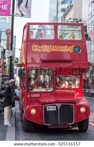 TORONTO,CANADA-AUGUST 12,2015:Red colour double-deck open top City Sightseeing tourist bus.City sightseeing was started in 1999 in Spain and now has spread to more then 100 locations across the world.
