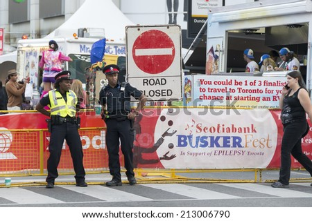 TORONTO,CANADA-AUGUST 23,2014: Scotiabank Buskerfest a celebration which closed Younge St. with multiple stands to help Epilepsy Toronto.  - stock photo