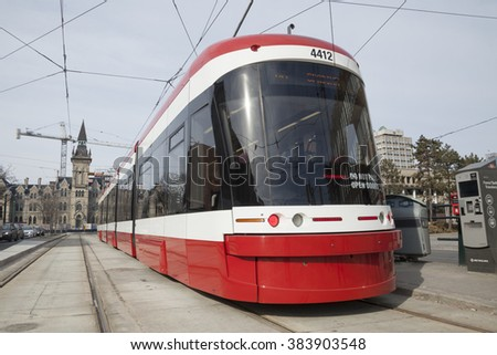 TORONTO, CANADA -?? CIRCA FEBRUARY 2016: New style street car of the Toronto Transit Commission in downtown Toronto - stock photo