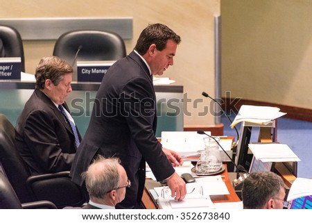 TORONTO,CANADA-DECEMBER 9,2015: Councillor Giorgio Mammoliti speaking in the Toronto City Council during deliberations about the taxi industry and Uber. City Council  is working on a regulating bylaw - stock photo