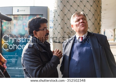 TORONTO,CANADA-DECEMBER 9,2015: Councillor Jim Karygiannis (wearing suit) during the protests of Toronto taxi drivers against the unfair operation of UberX in front of City Hall. - stock photo