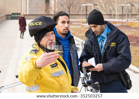 TORONTO,CANADA-DECEMBER 9,2015: Incidents involving Toronto Police during taxi drivers protest againt the unfair operation of UberX in the city and the lack of regulation by the Municiapal Government