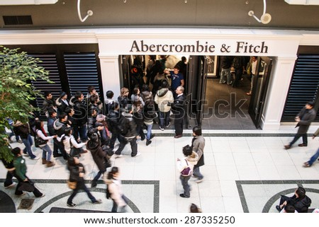 Toronto, Canada - 26 December, 2007 - people wait in line to enter an Abercrombie & Fitch's store.  - stock photo