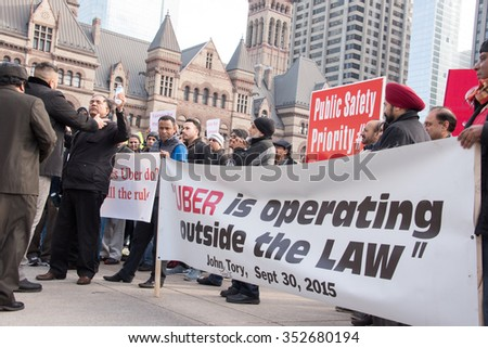 TORONTO,CANADA-DECEMBER 9,2015:Scenes from the taxi drivers protest against the unfair competition from Uber. Uber needs to be regulated but the bylaw is not ready yet. Uber continues to operate. - stock photo