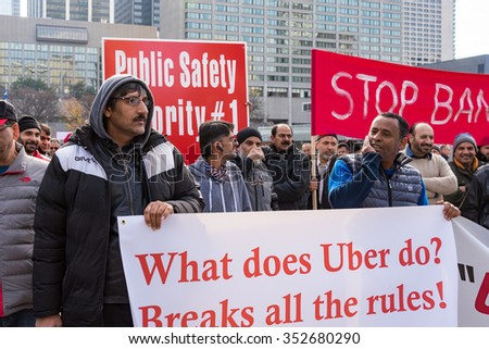 TORONTO,CANADA-DECEMBER 9,2015:Scenes from the taxi drivers protest against the unfair competition from Uber. Uber needs to be regulated but the bylaw is not ready yet. Uber continues to operate.
