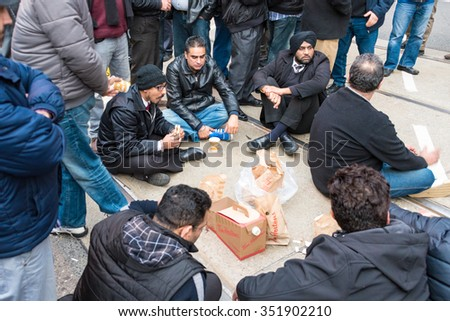 TORONTO,CANADA-DECEMBER 9,2015: Taxi drivers protest agaist Uber and the city lack of regulation that creates an unfair competition. The protest blocked a main intersection in downtown for hours. - stock photo