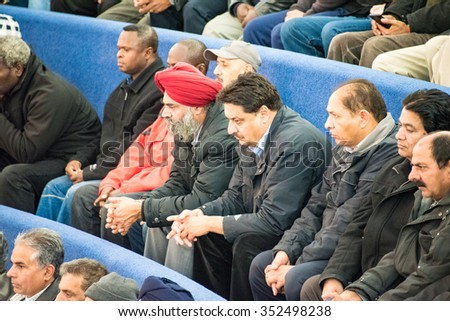 TORONTO,CANADA-DECEMBER 9,2015: Toronto taxi drivers observe the City Council deliberations inside City Hall as part of the protest againt UberX - stock photo