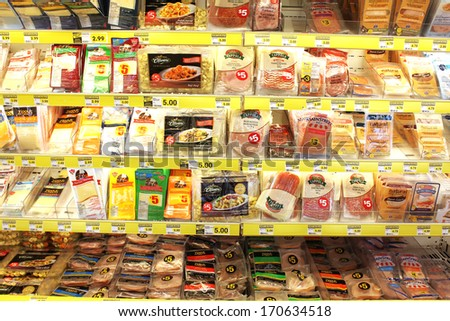TORONTO, CANADA - DECEMBER 18, 2013: Variety of processed meats and prepacked foods in a grocery store. North America is one of the leading consumers of processed meats in the world. - stock photo