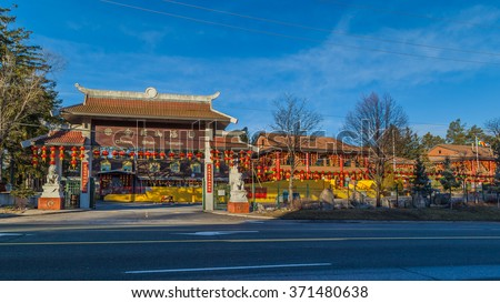 TORONTO, CANADA - February 01, 2016: Cham Shan Temple  Cham Shan is the oldest Chinese Buddhist temple in Toronto. Each Chinese New Year, worshipers lined up to make offerings and light incense.   - stock photo