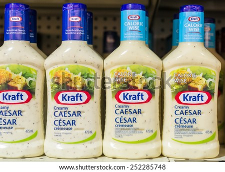 TORONTO,CANADA-FEBRUARY 11,2015: Kraft Ceasar Salad dressing in shelves. Kraft Foods Group, Inc. (KRFT) is an American grocery manufacturing and processing conglomerate headquartered in the Chicago - stock photo