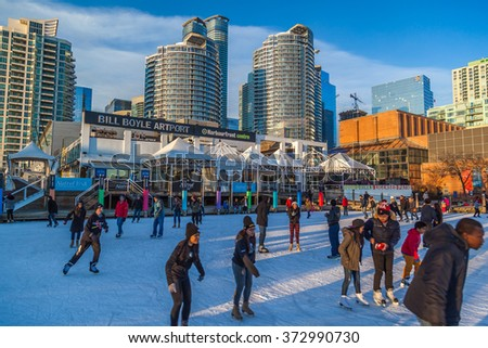TORONTO, CANADA - February 06, 2016: People skating at Harbourfront Centre public skating rink