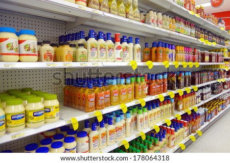 TORONTO, CANADA - FEBRUARY 11, 2014: Salad dressings selection in a supermarket shelf in Toronto, Canada. - stock photo