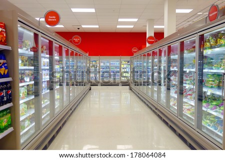 TORONTO, CANADA - FEBRUARY 11, 2014: The frozen food aisle in a supermarket in Toronto, Canada. - stock photo